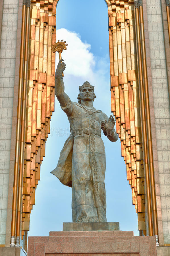 Statue of Somoni. Dushanbe, Tajikistan. Dushanbe, Tajikistan - 15 August 2014, 13 meters high State coat of arms in hands of Somoni, and a crown on his head stock image