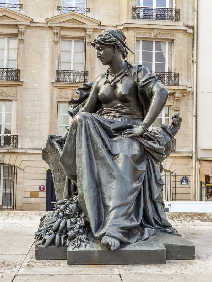 Statue of South America in front of d`Orsay Museum stock photo