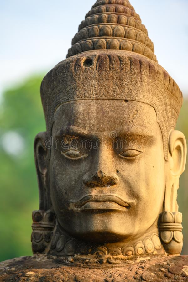 Statue on South Bridge, Entrance of Angkor Thom, Khmer styled Temple, Siem Reap, Cambodia. One of the smiling face sin Angkor Thom. Angkor Thom built in the stock photography
