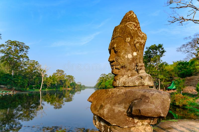 Statue on South Bridge, Entrance of Angkor Thom, Khmer styled Temple, Siem Reap, Cambodia. One of the smiling faces in Angkor Thom. Angkor Thom built in the stock photo