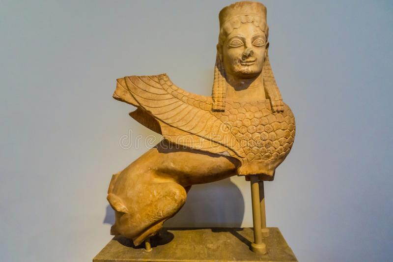 Statue of a sphinx from Spata of Greece. Marble statue of a sphinx, found at Spata, Attica, Greece 570-550 B.C stock photography