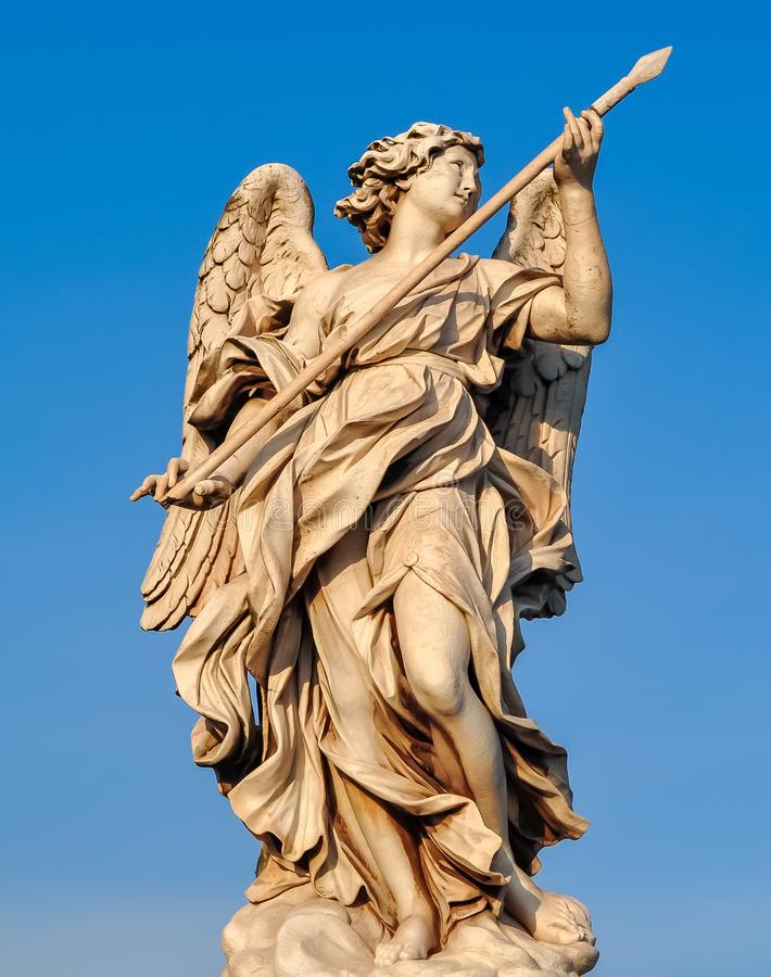 Statue on St. Angel bridge Ponte Sant`Angelo in Rome, Italy royalty free stock photo