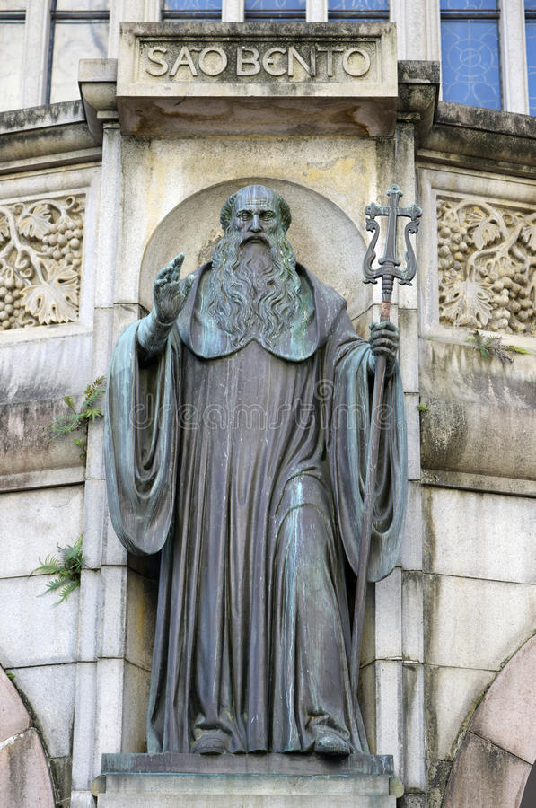 Statue of St. Benedict in the facade of the abbey of Our Lady of royalty free stock photography