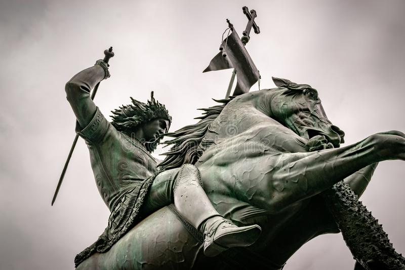 Statue of St George and the dragon in Berlin. The contrasted image gives more drama to the scene stock photo