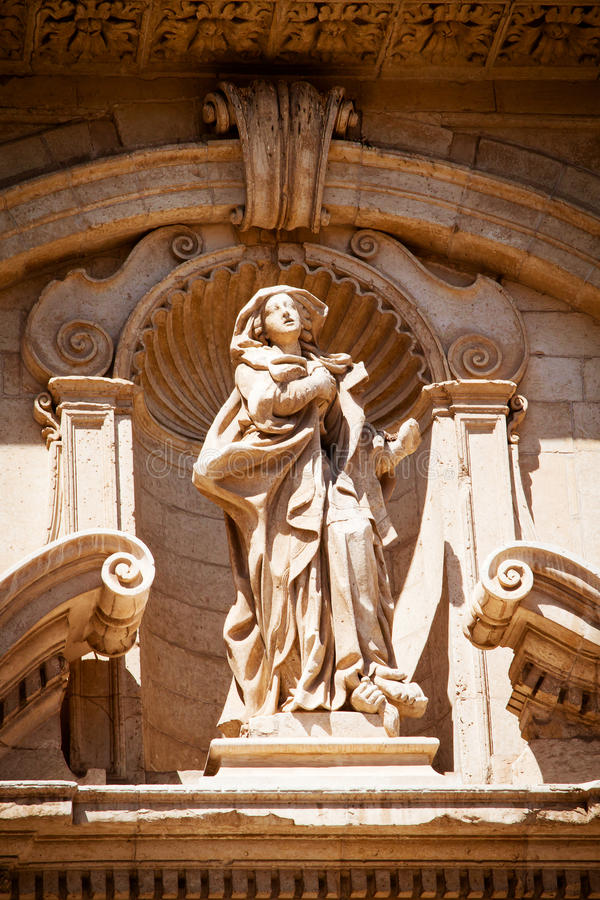 Statue of St Irene. The statue of St Irene by Mauro Manieri (1717) on the facade of the eponymous church in Lecce, Puglia stock photography