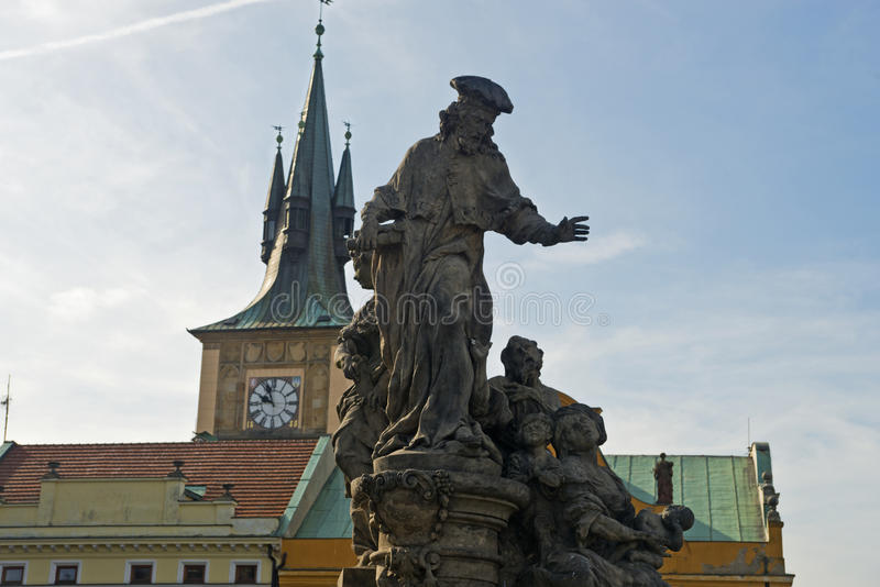Statue of St. Ivo of Kermartin, Charles Bridge, Prague,Czech Republic. Ivo Helory, a legal scholar from Kermartin, France, served as an ecclesiastical judge in royalty free stock photos