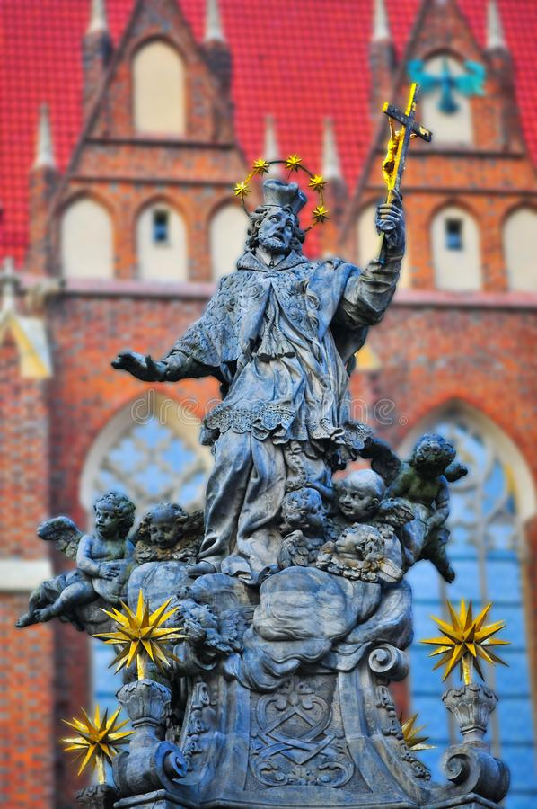 Statue of St. John of Nepomuk, 18th century monument, Ostrow Tumski, Wroclaw, Poland, January 2018. Bokeh stock photography