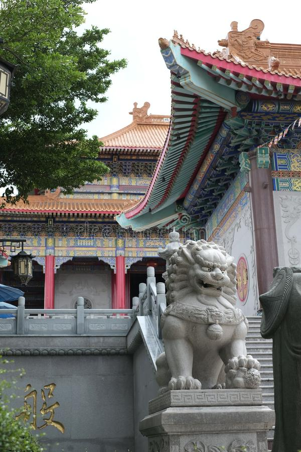 Statue of stone lion at a Chinese temple. Yesterday,I travel to visit the most beautiful Chinese temple in a province nearby the capital city of Thailand and stock photo