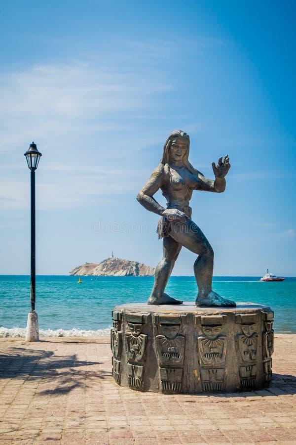 Statue of a Tayrona woman, Santa Marta, Colombia. Statue of a Tayrona woman with the sea in the background at Santa Marta, Colombia royalty free stock image