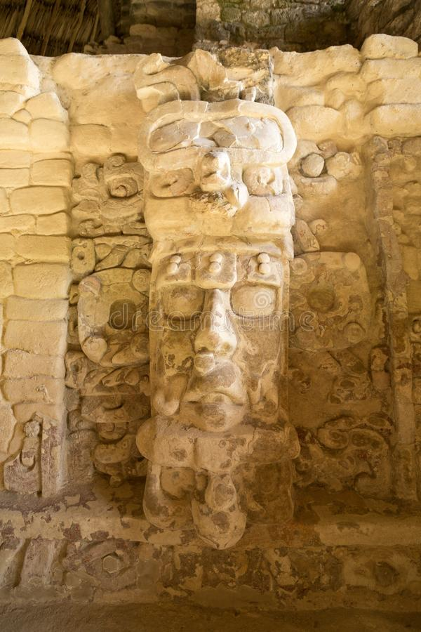 Statue on the Temple of the Masks at Kohunlich Mexico. Well preserved statue on the Temple of the Measks at Kohunlich maya archaeological site in Quintana Roo stock image