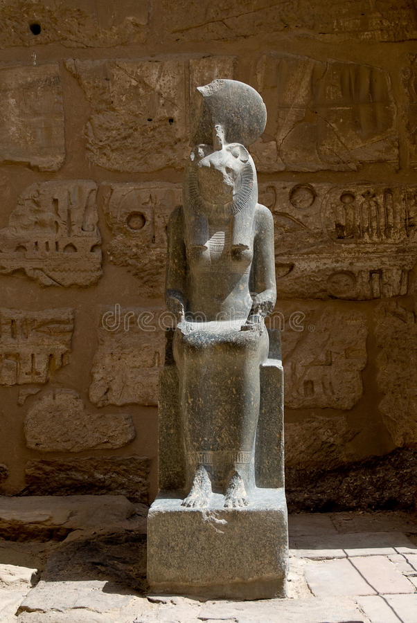 Statue in the temple at Medinat Habu. Statue of a pharaoh at the temple of Medinat Habu in Luxor stock image