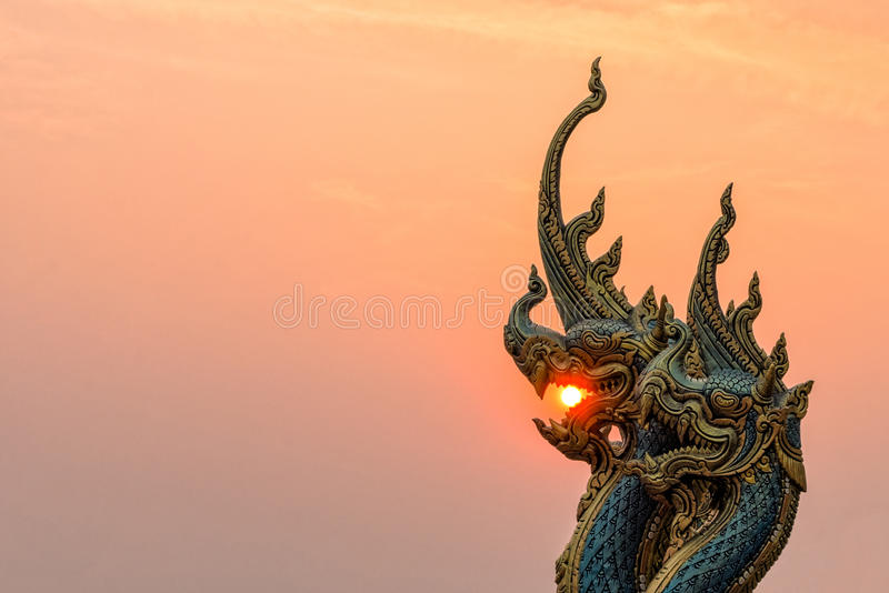 Statue at Temple Sirindhorn Wararam Phuproud. Beautiful Statue at Temple Sirindhorn Wararam Phuproud in Ubon Ratchathani Province with sunset sky, Thailand.The stock photography