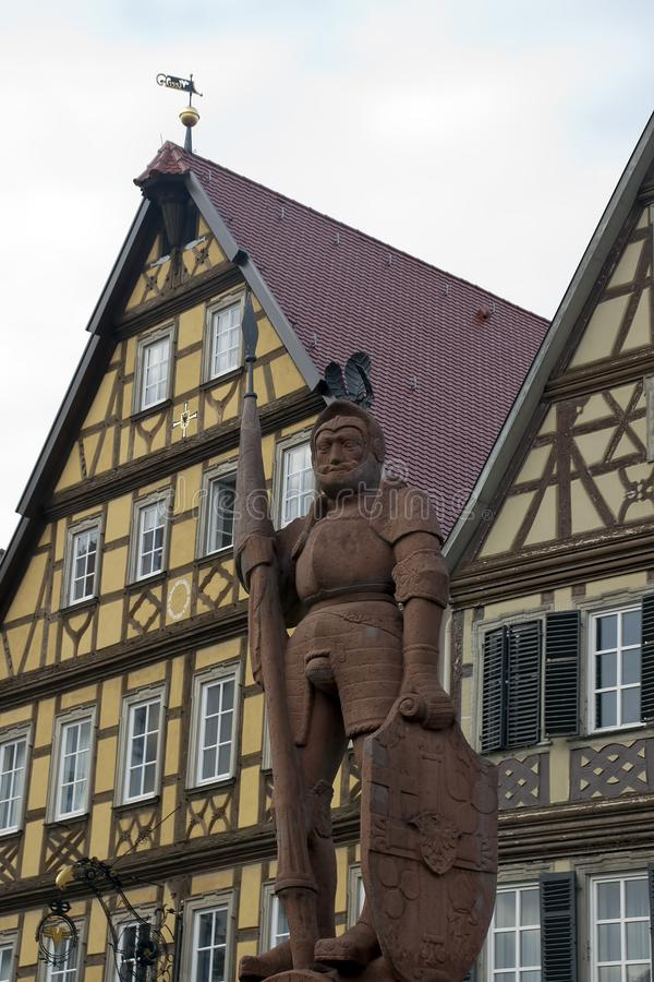 1926 statue of Teutonic knight in front of traditional half-timbered houses royalty free stock image