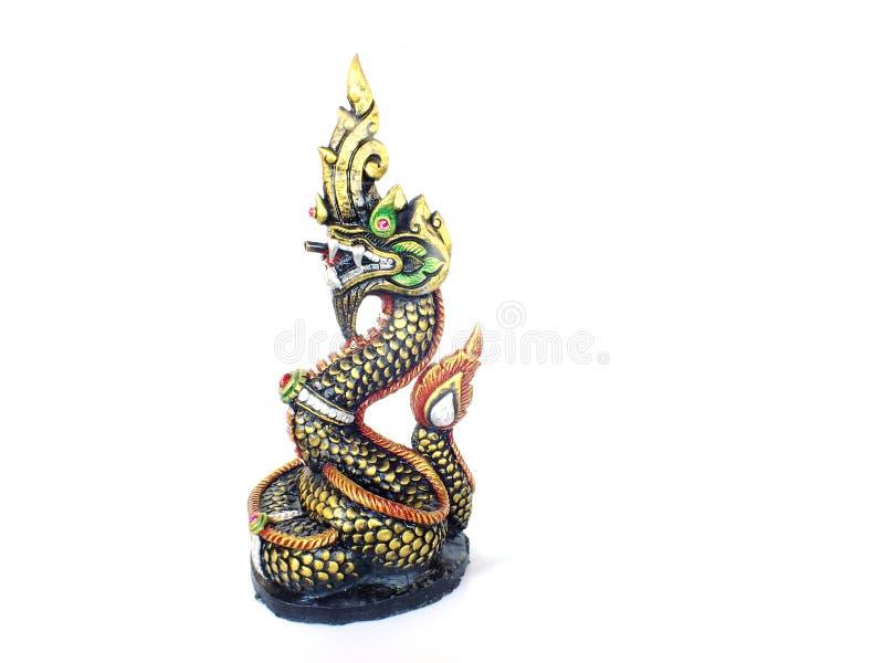 Statue thaïlandaise de naka de dragon de bouddhisme d'isolement sur le fond blanc image libre de droits