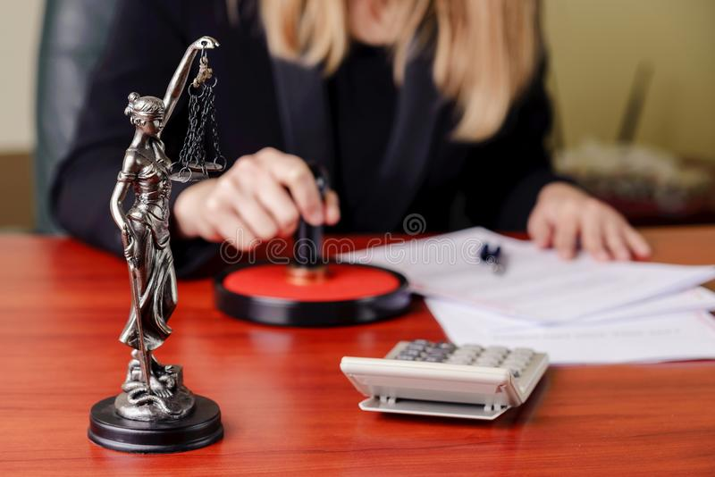 The statue of Themis on desk stock image