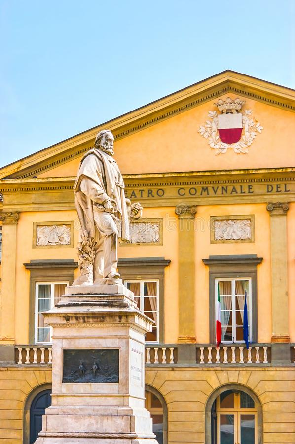 The statue to Giuseppe Garibaldi in Lucca, Italy. The marble statue to Giuseppe Garibaldi in Piazza del Giglio with frontage of Opera Theater on the background royalty free stock images