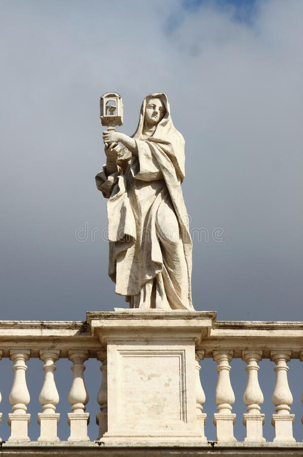 Statue on top of Saint Peter Basilica stock images