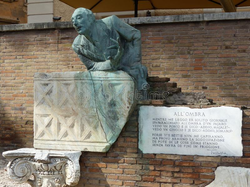 The statue of Trilussa in Trastevere district in Rome. Italy. The statue of Trilussa in Trastevere district in Rome, Italy. Memorial of a roman poet. Brick red stock image