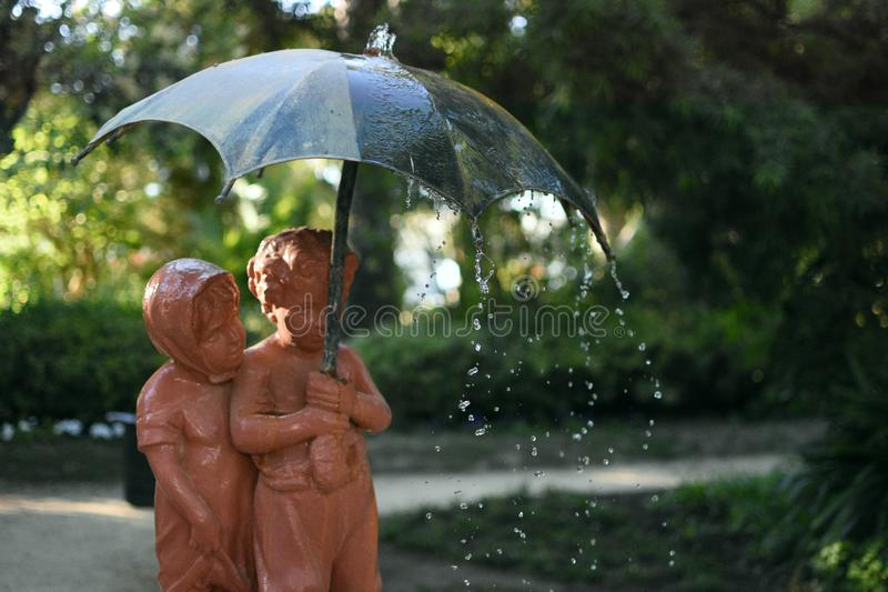 Statue of two children stock photo