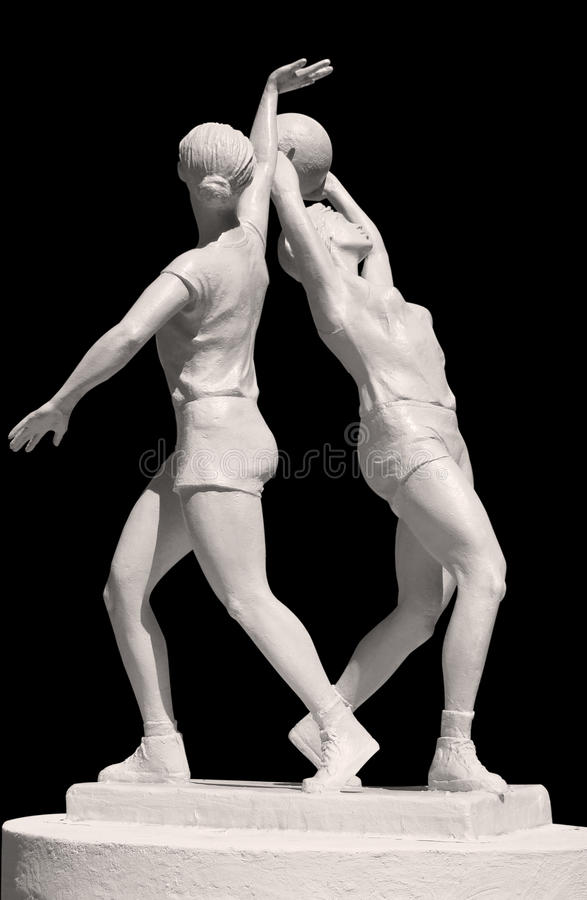 Statue Of Two Sportish Girls With Volleyball Stock Photo