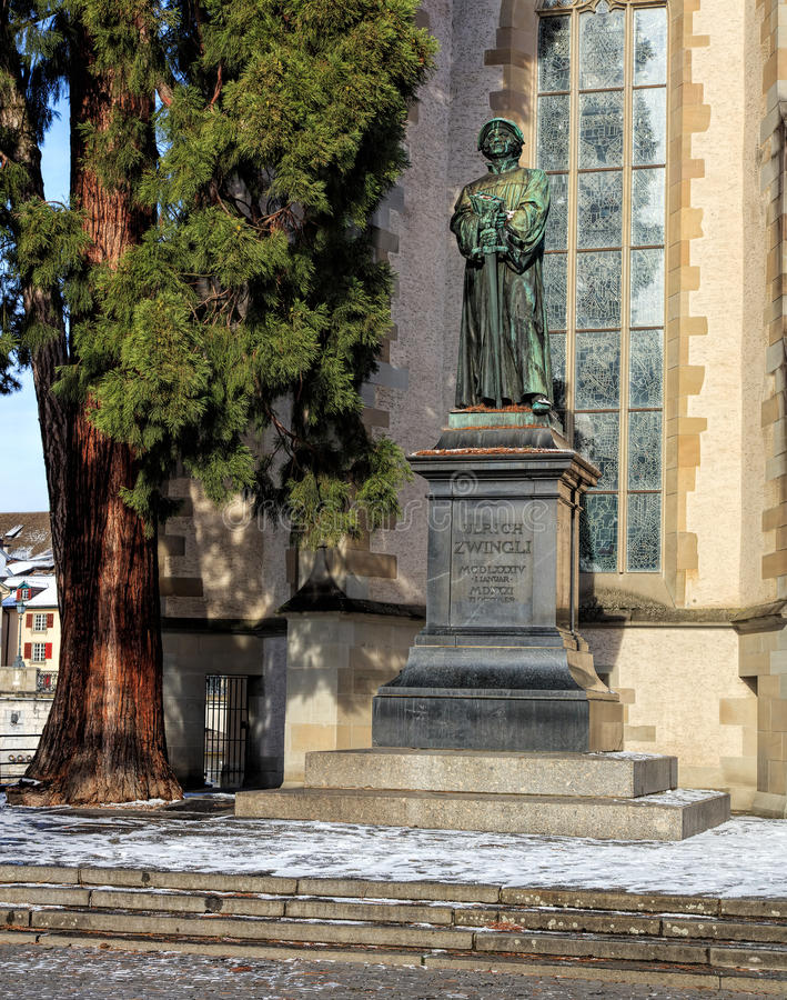 Statue of Ulrich Zwingli at the Water Church. Zurich, Switzerland - 18 January, 2016: statue of Ulrich Zwingli at the Water Church. The bronze statue by sculptor stock photo