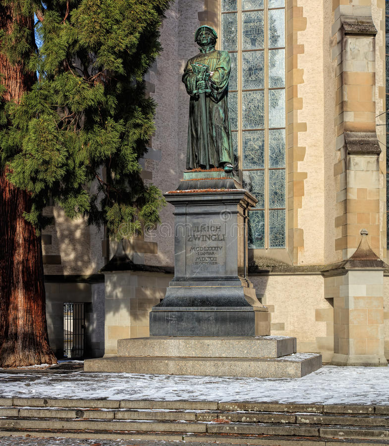 Statue of Ulrich Zwingli at the Water Church in Zurich. Zurich, Switzerland - 18 January, 2016: statue of Ulrich Zwingli at the Water Church. The bronze statue royalty free stock image