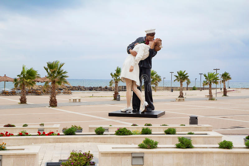 The statue Unconditional surrender on the waterfront Italian city Civitavecchia (Italy). The famous statue of two lovers kissing Navy(sailor and nurse) on the stock photos