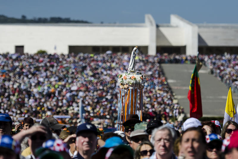 The statue of the Virgin Mary of Fatima being carried among the crowd of people at the Sanctuary of Fatima stock photography
