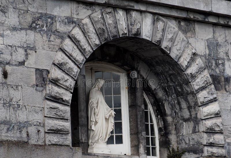 Statue Of The Virgin Mary In Nenagh Ireland. Statue of the Virgin Mary with stone building in Nenagh Ireland stock image