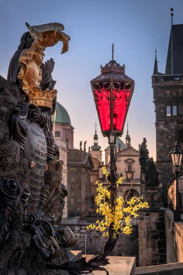 Statue of the Virgin with St. Bernard. With a newly restored red lamp. Prague stock photos