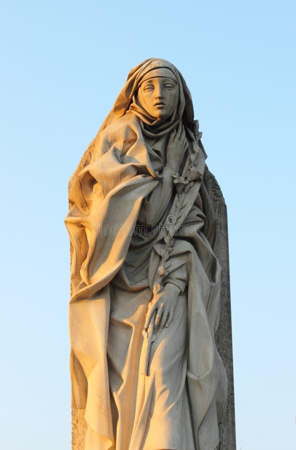 Statue von St. Catherine von Siena in Rom stockbilder