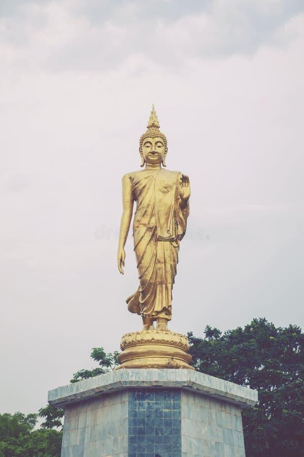 Statue of walking Buddha enshrined at Bung Phalanchai Lake, Roi Et Province, northeastern Thailand.  royalty free stock images