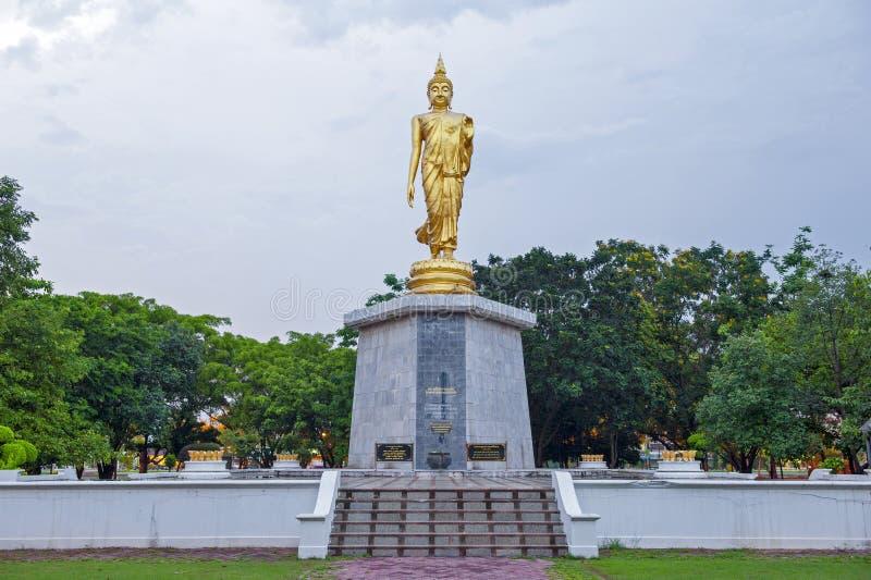 Statue of walking Buddha enshrined at Bung Phalanchai Lake, Roi Et Province, northeastern Thailand.  royalty free stock photography