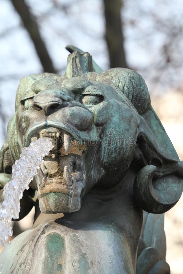 Statue at a water fountain. Abstract of a statue or water fountain outdoors in a park showing detail stock images