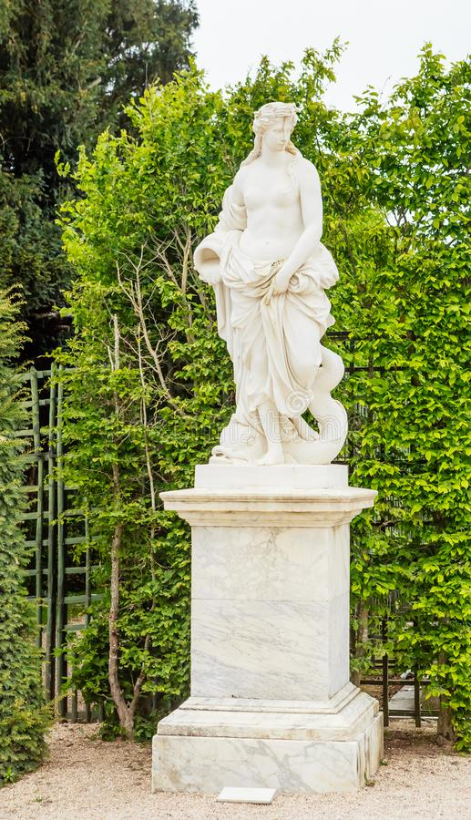 Statue Water by Pierre Le Gros. Park of the Palace Versailles. France royalty free stock photo