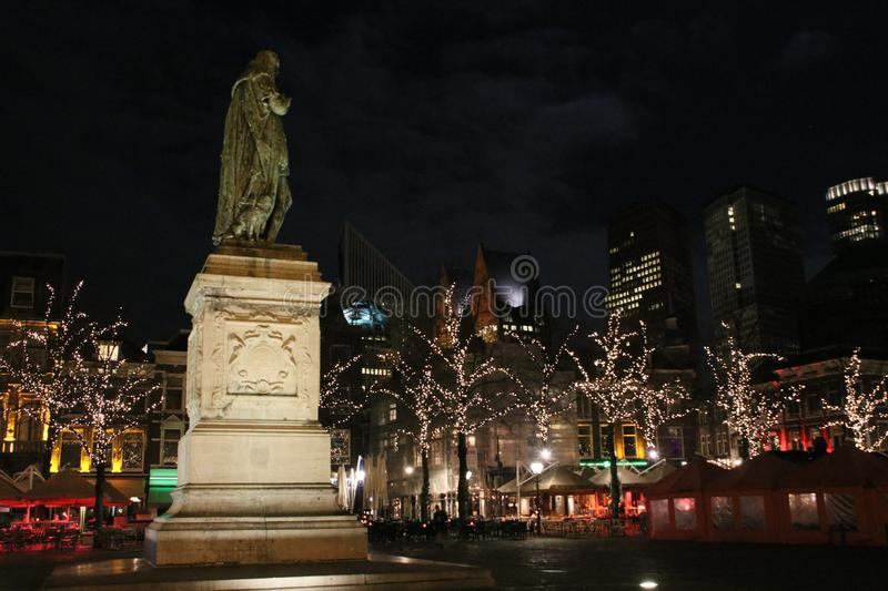 Statue of willem of orange at square named Plein at night in the city center of The Hague in the Netherlands with christmas lights stock photos