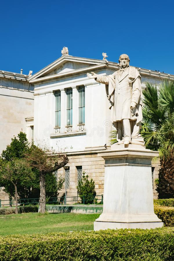 Statue in front of the University of Athens, Greece royalty free stock photo