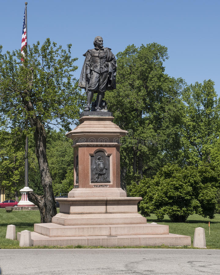 Statue of William Shakespeare in Tower Grove Park. Pictured is a statue of William Shakespeare standing with a heavy coat draped over his shoulders and in his stock photo