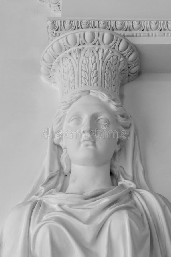 Statue of woman. Marble sculpture female bust. Caryatid stained sculpture adorns the old house facade.  stock images