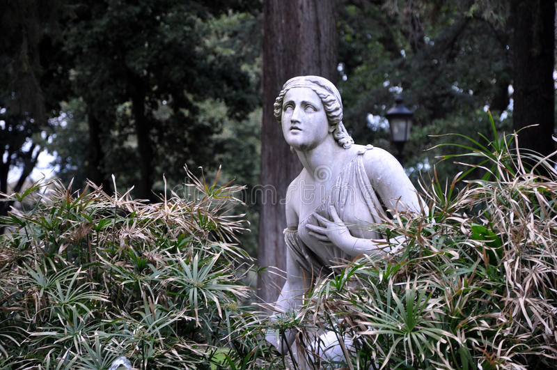 Statue of woman in Villa Borghese gardens royalty free stock photos