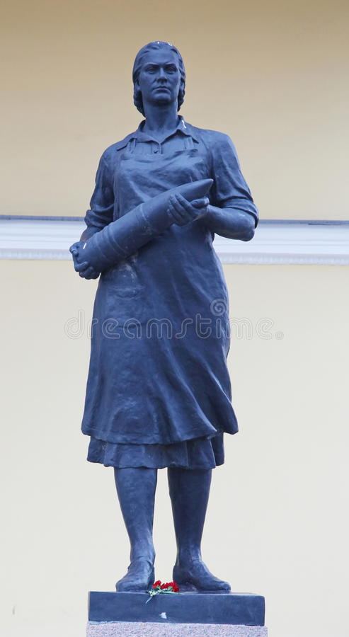 Statue of women workers from an artillery shell. The labor monument to the heroism of female fighters. royalty free stock images