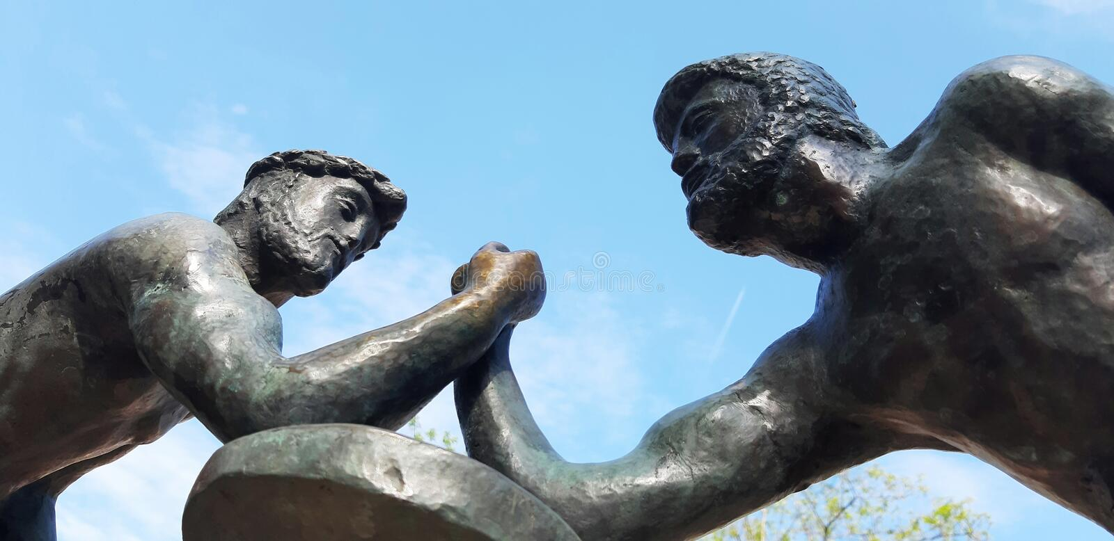 Statue wrestling at the hands of Riviera Park . Russia Sochi 04.28.2019. Statue wrestling at the hands of Riviera Park . Sochi 04.28.2019 royalty free stock photography