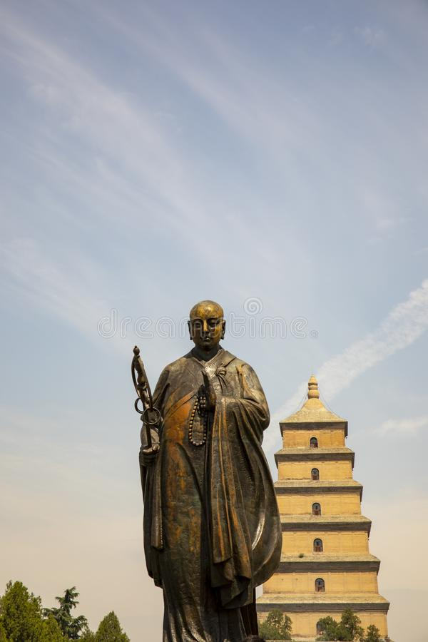 Statue of Xuanzang standing in front of Big WIld Goose Pagoda, stock photography