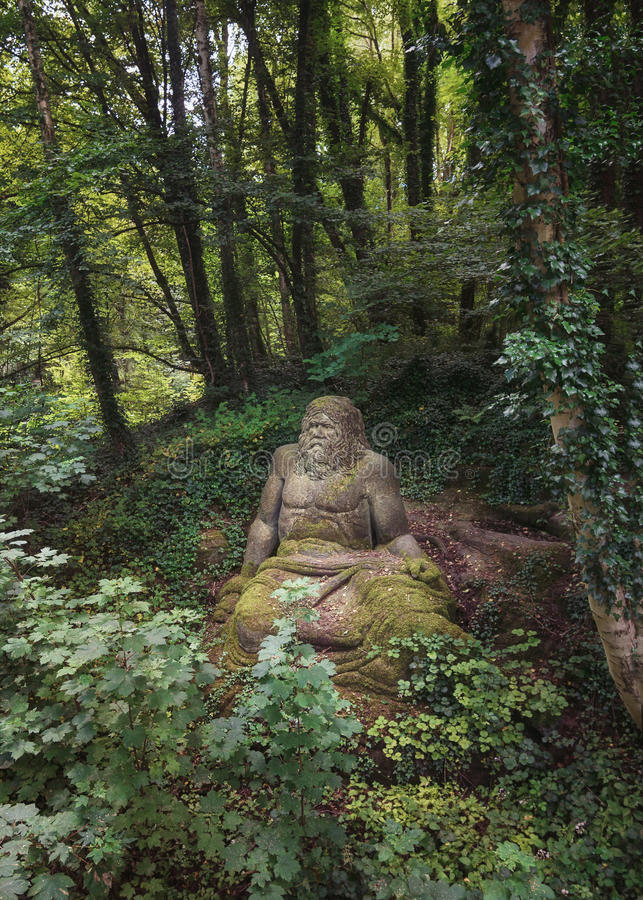 Statue of Zeus in the folies forest of Parc Mondo Verde. Landgraaf, Netherlands – July 12, 2016: Statue of Zeus in the folies forest of Parc Mondo Verde royalty free stock image