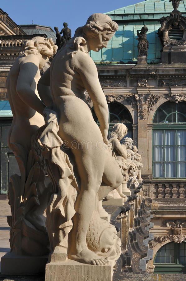 Statue at zwinger, dresden. Sunny sandstone statue at a famous baroque palace and museum in dresden, the building has been rebuilt after second world war damages stock photography