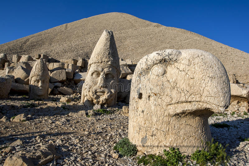 Statues of Apollo left, Zeus centre and and a Persian eagle god right on the weatern face at Mt Nemrut in Turkey. stock image