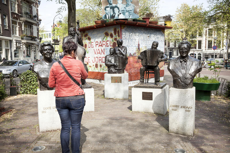 statues in bronze of famous artists from the Jordaan in amsterdam stock photography