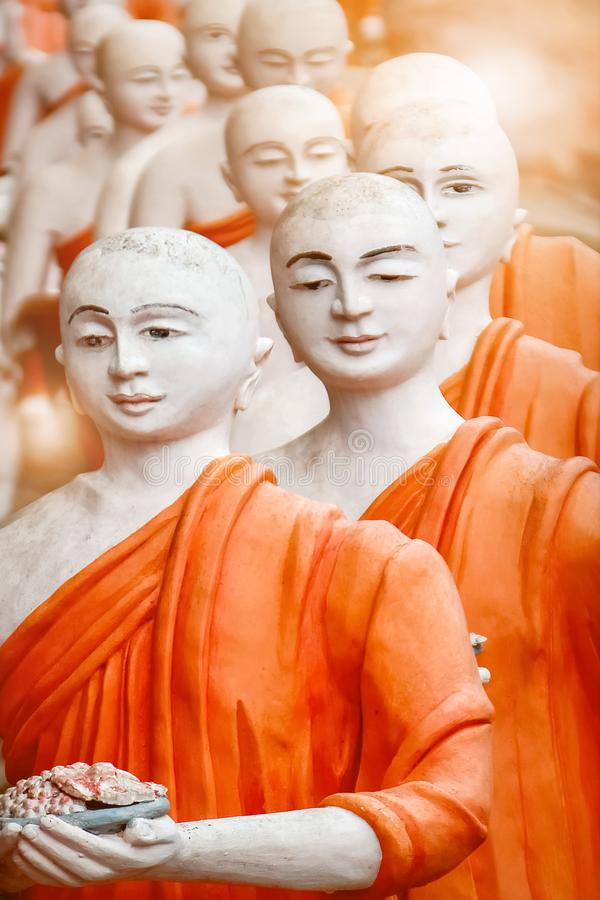 Statues of Buddhist monks in Dambulla Cave Temple outside. Sri Lanka.  stock photography