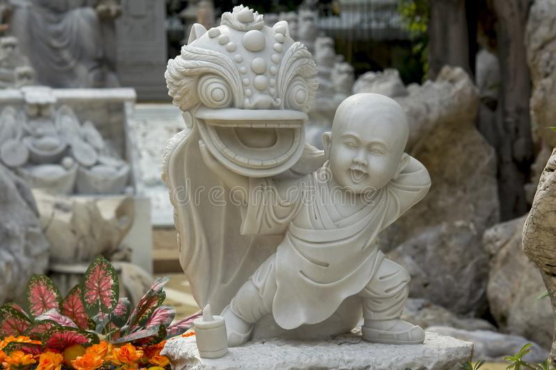 Statues carved from marble in Chinese style are unique. The statue was carved from marble in the form of China is unique royalty free stock photography