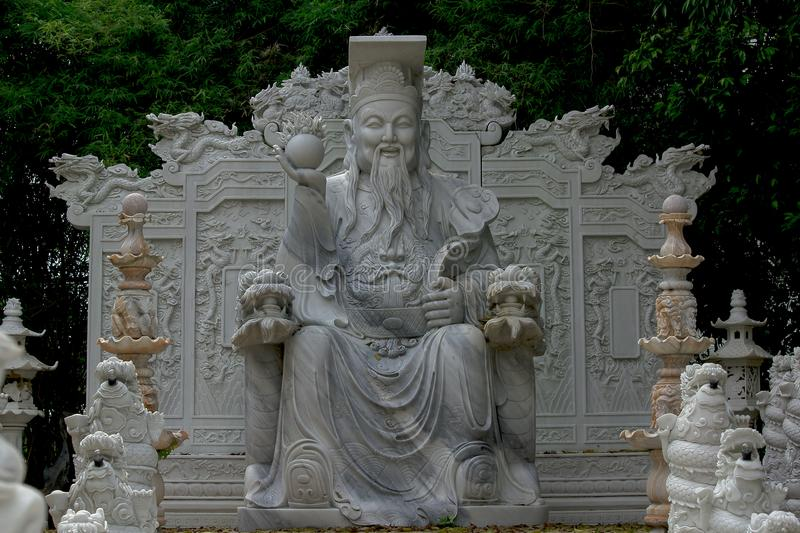 Statues carved from marble in Chinese style are unique. The statue was carved from marble in the form of China is unique stock images